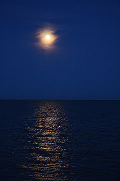 Photography by Cliff Homewood - Dark blue night sky and moon across the English Channel