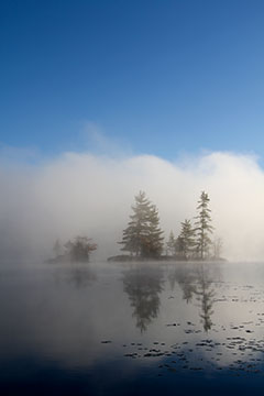 islands with mist rising: photo by Cliff Homewood
