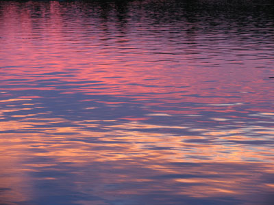 photo by cliff homewood rainbow colors reflected in lake